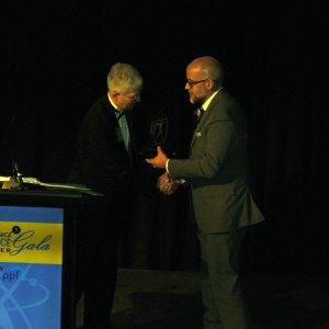 Michael Rice, VP of marketing for Follett, LLC., presented the Educator Excellence STEM Leadership Award to Ignacio Jayo, a science teacher at William Tennent High School.